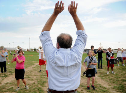 Nelson County band director Marc Monroe conducts members of the marching band after school Monday. Monroe, 39 students and 15 parents are going to New York City to march in the Veterans Day Parade in November with the help of donations. The band is still raising money.