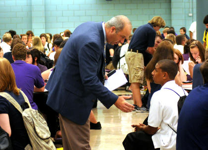 Bardstown High School Principal Chris Pickett talks to Kevin Cong on the first day of school Wednesday.