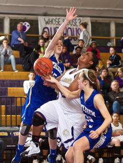 Bardstown's Tocoya Hughley is whacked on her way to the basket by Bethlehem's Kristen Crepps, left, and Megan Spalding during the Tigers' 55-50 win Jan. 14.