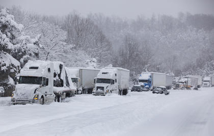 The westbound lane of the Bluegrass Parkway is blocked by semi trucks and other vehicles stuck on the incline near the intersection with I-65 Thursday.