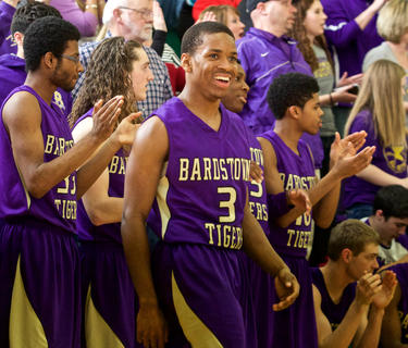 Bardstown's Santrel Farmer flashes a smile after the Tigers' 62-48 region semifinal win Monday over Elizabethtown. Farmer hit 9-of-10 free throws during a 16-point night.