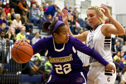 Bardstown's BreAsia Spalding tries to avoid the trap by Thomas Nelson's Hannah Wolf in the Generals' 45-44 win Jan. 17.