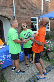"Leon and Margaret Claywell of Medica Pharmacy yuck it up with Cecil Ellis, ""the Running Man"" after the Nelson County Community Clinic's 5K race Saturday."