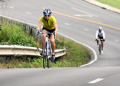 Bicyclists pedal uphill on East Stephen Foster Avenue during the final stretch of My Old Kentucky Home Bike Tour Saturday.