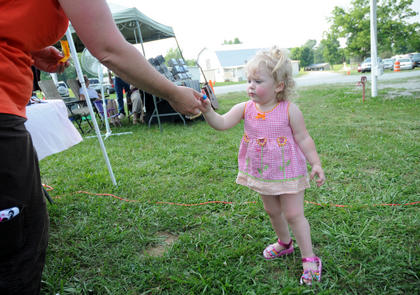 Hailey Waldridge receives candy from Pam Waldridge at The Bardstown Bluegrass Festival at White Acres Campground, Saturday.