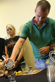 """Jeff Shaw, manager of the Bourbon Bistro in Louisville, pours his drink, """"Cider Car,"""" for the judges at Wednesday's Mixed Drink Challenge."""