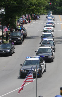 Bardstown Police Department cruisers led the funeral procession for their fallen comrade, Jason Ellis, on Thursday. Hundreds of law enforcement personnel from across Kentucky and several states came to Bardstown to mourn the loss of Ellis.