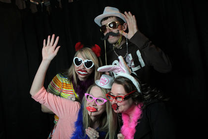 Friends enjoy the Art House Photo Booth at the Kentucky Standard Bridal Fair Sunday