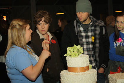 Chelsea Ryan, owner of Just Baked, talks to a bride, groom and mother of the bride about the various types of cakes she could offer for their wedding at the Kentucky Standard Bridal Show.