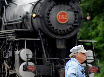 Charlie DeWitt watches for traffic near Boston Food Mart. The vintage train was built in 1905 and is the oldest known of its kind.