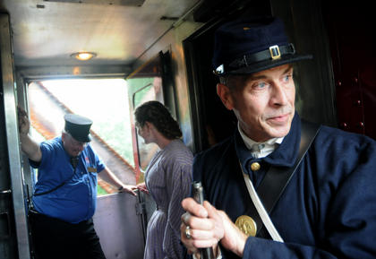 Civil War reenactor Bruce Fortin looks out the window as engine 152 crosses the Beech Fork River.