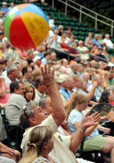 Fans of Pail Revere and The Raiders toss a beach ball in the J. Dan Talbott Amphitheater Monday.