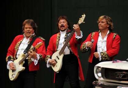 Paul Revere and the Raiders play a set for fans at the J. Dan Talbott Amphitheater Monday.