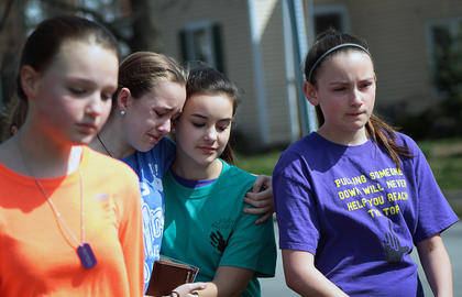 Friends comfort one another as they join the walk to remember Reagan