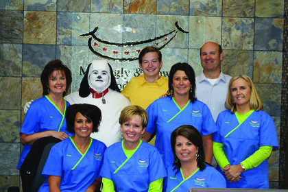 Charlie Brown and Snoopy visited with Mattingly & Howell Orthodontics, July 29.