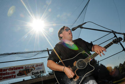 Musician Ryan Raikes, Bardstown, plays Johnny B. Goode at the first annual Bardstown-Nelson County Chili Cook-Off Saturday.