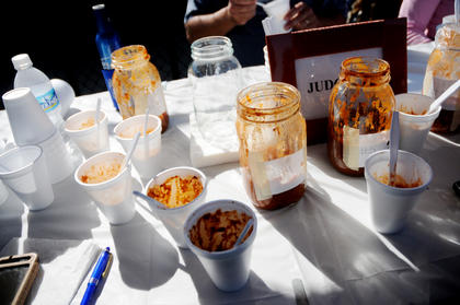 Empty jars of chili sit on the table after judges take samples at the first annual Bardstown-Nelson County Chili Cook-Off Saturday.