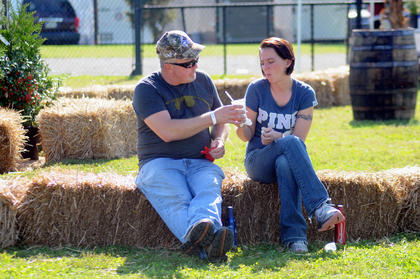David Medley, Bardstown, hands a cup of chili to Shauna Sorrelo, Bardstown at the first annual Bardstown-Nelson County Chili Cook-Off Saturday.