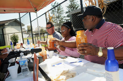 Bardstown Mayor Bill Sheckles judges chili with others during the first annual Bardstown-Nelson County Chili Cook-Off Saturday.