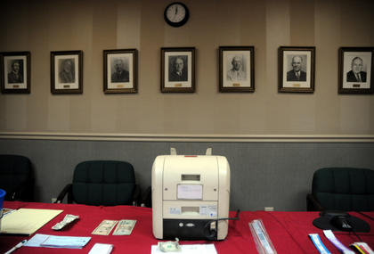 A machine used to count donations to The WHAS Crusade For Children sits in the boardroom at The Bardstown Fire Department Saturday.