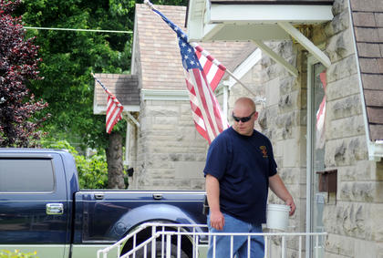 Bardstown firefighter Josh Wright knocks on doors Sunday to collect money for the 2011 WHAS Crusade For Children.