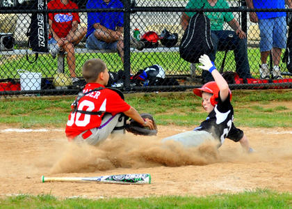 Cannon Simpson of the Nelson Co. U8 All-Stars slides into home against South Hardin during last month's Officer Jason Ellis Memorial Baseball Tournament.