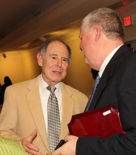 Dr. Steve Auslander, left, one of the founders of the dental program at the Nelson County Community Clinic and a Chamber of Commerce Hall of Fame Award recipient, talks with Mike Brooks, the Filkins Volunteer Award recipient for the past year.