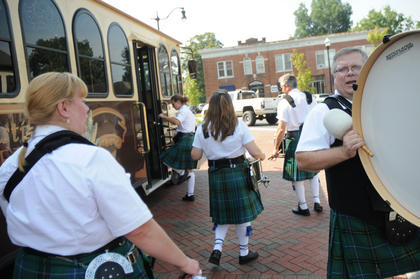 Eric Henninger, a drummer for the Louisville Pipe Band, prepares to board a trolley bound for the Wickland Highland Games and Celtic Festival Saturday.