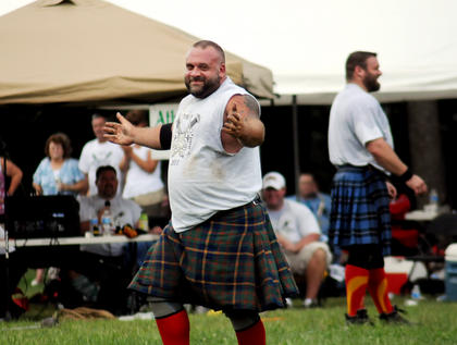"""Mark Valenti, top 10 pro-athlete and multi-Canadian games champion from Ohio reacts after competing in the """"caver toss"""" at the Wickland Highland Games and Celtic Festival Saturday."""