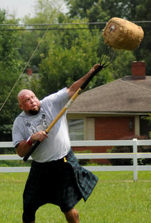 Brian King tosses a sheaf during the Wickland Highland Games and Celtic Festival Saturday.