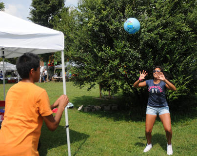 Nicolas Godenzi, Bardstown and Danielle Godenzi toss a ball at the Wickland Highland Games and Celtic Festival Saturday.