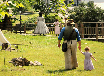 Folks young and old, dressed in Civil War period clothing, roam the grounds of Old Bardstown Village.