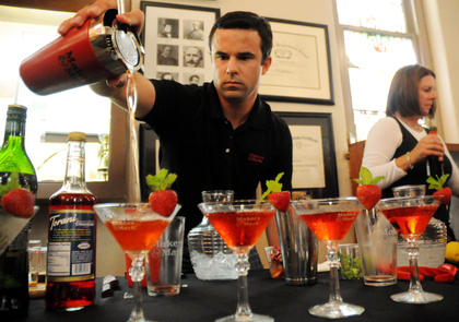 """Kevin Didio, a diplomat from Maker's Mark Distillery, makes his drink, """"Strawberry Fields,"""" at the Mixed Drink Challenge Wednesday. Didio's drink won the challenge and his drink will be the official drink of next year's Kentucky Bourbon Festival."""