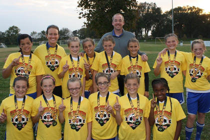 The Nelson Elite Thunder took first place at the Kick or Treat Classic in Bowling Green the weekend of Oct. 26. The team went 4-0 on the weekend, clinching the championship game in penalty kicks. Team members include (front) Anna Sims, Haylee Evoy, Ella Blair, Emma Livingston, Macie Rawlins, Matija Yocum (middle) Jaila Parker, Emma Settles, Ella Thompson, Kendall Disponett, Ella Dodd, Isabella Russell, Ginny Spalding and (back) assistant coach Kristen Zutterman and head coach Jody Spalding.