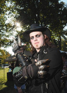 Dan Smith, Bardstown, poses for a photo wearing goth atire in front of Spalding Hall during the Bardstown Arts, Crafts and Antiques Festival Saturday.