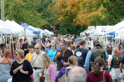 The crowd swelled on Sunday at the Bardstown Arts, Crafts and Antiques Fair. Visitors to the fair gathered on West Flaget Street under the first signs of fall foliage.