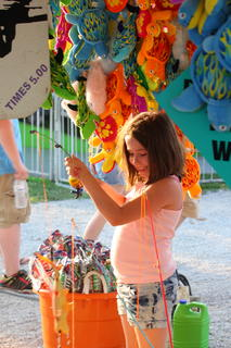 Gabby Abell, 9, fished out a winner Monday at one of the many games along the Nelson County Fair midway.