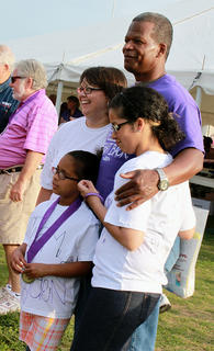 """George Hayden didn't know he would encounter a Team Hayden at Relay for Life's May 13-14 event. """"They surprised me with this,"""" he said as he posed for a picture with daughters Danielle Hayden, right, and Jenna Hayden and girlfriend Rachel Lyvers."""
