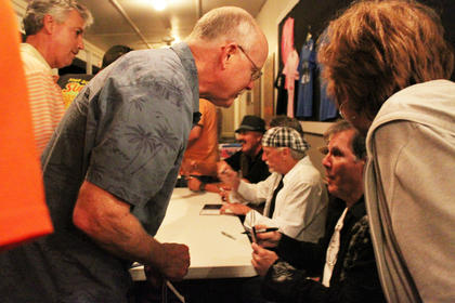 Fans crowd around Exile band members to get autographs Monday night.