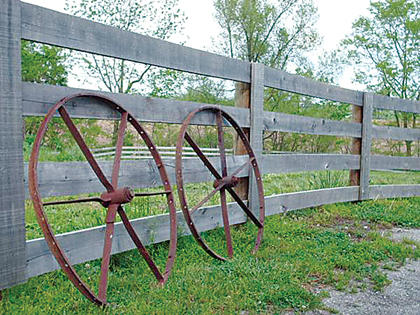 """This photo was taken in 2007 while visiting an old farmhouse in Nelson County. """"I love the way the wheels are 'resting' along the fence, after years of carrying things where they needed to go,"""" Stump said."""