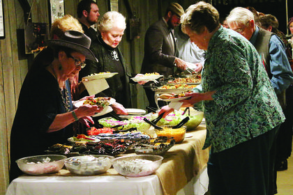 Guests wait in a buffet line at Saturday's Boots & Bling event at the Blue Grass Entertainment and Exposition Complex.