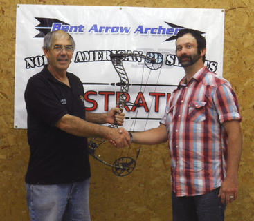 Kentucky Standard outdoors columnist and Bent Arrow Archery owner Gene Culver, left, presents Jeremy Skaggs with his new limited edition Mathews Creed bow, the prize for the highest score in the Culvertown 3-D Archery Shoots.