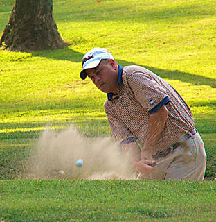 Todd Schwartz in the sand at My Old KY Home State Park Golf Course, Hole No. 9. Photo was taken by Holly Schwartz.
