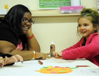 Stephanie Calhoun makes crafts with Kailey Knight at the Harvest Party at Nelson Christian Church Friday.