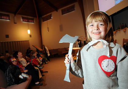 """Becca Hatfield dresses as the Tin Man from """"The Wizard of Oz"""" at the harvest party at Nelson Christian Church Friday."""