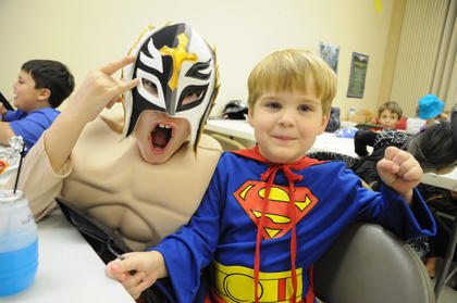 T.J. Karr dresses as wrestler Rey Mysterio and Cash Sweazy dresses as Superman at the harvest party at Nelson Christian Church Friday.