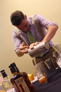 Jared Schubert, who represented Heaven Hill Distilleries during Wednesday's Mixed Drink Challenge, pours his drink for the judges.