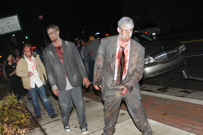 John Gritton get into character as he participates in a Zombie Walk down North Third Street Saturday night.