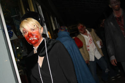 Ashley Baird participates in a Zombie Walk down North Third Street Saturday night.