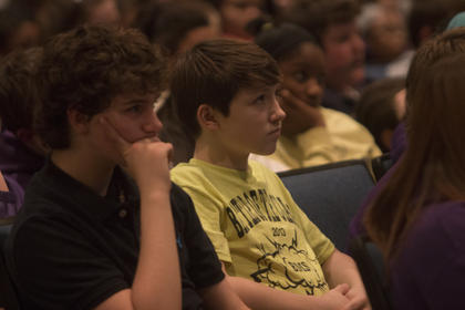 Ben Beavers, left, and Keldon Tilley, eighth graders at Bardstown Middle School, listen to a presentation Friday by Scott Harvey, a Nicholasville Police officer, who spoke to students about how they can prevent bullying.